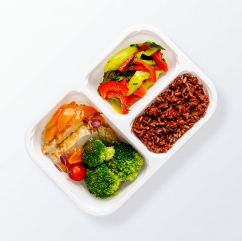 Spicy turkey with apricots and pak choi, steamed vegetables, red rice