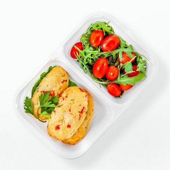 Millet-and-cheese chops with peppers and rocket, cocktail tomatoes with pumpkin seeds