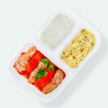 Lamb shashliks with tzatziki sauce, grilled tomatoes, couscous with sunflower seeds and fresh parsley
