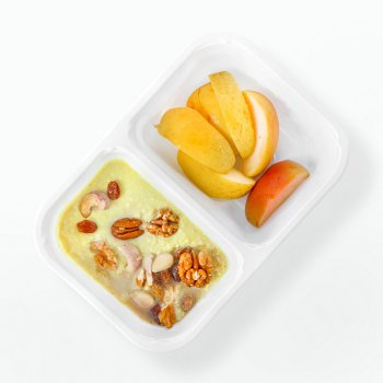Millet porridge with coconut milk, fruit & nuts, baked apple