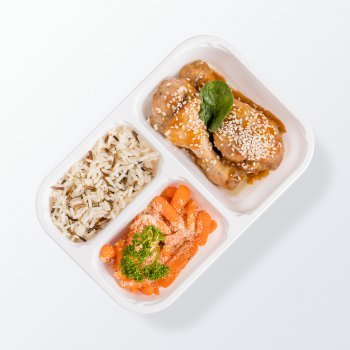 Chicken drumsticks with teriyaki sauce, white and wild rice, baby carrots