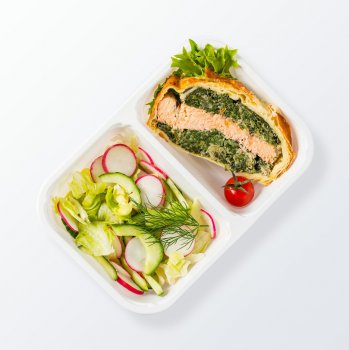 Salmon Wellington with courgette salad with olives and walnuts