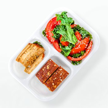Chicken meatloaf with vegetables, kale and tomato salad with sesame, bread